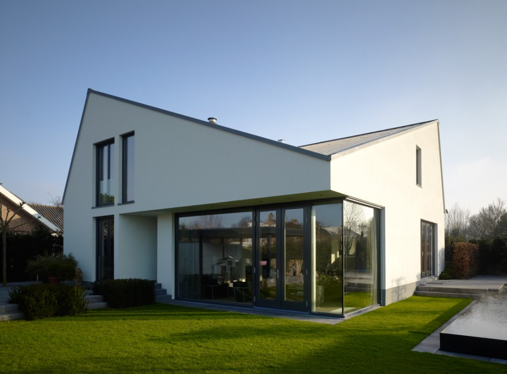 Modern house design stylish creative double roof1 awx2 blog for Modern home design blog